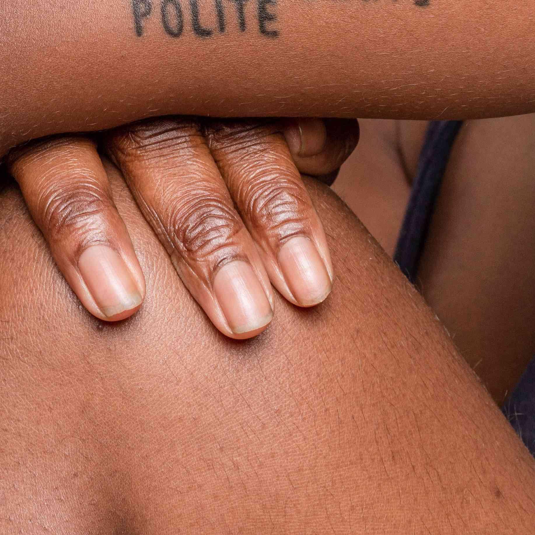 word tattoo on forearm