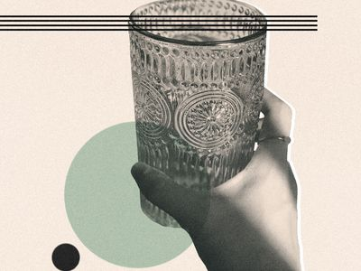 image of hand holding a drinking glass