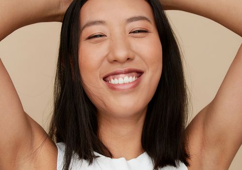 happy person with shaven underarms