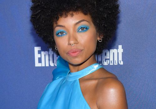 Logan Browning afro with electric blue shadow