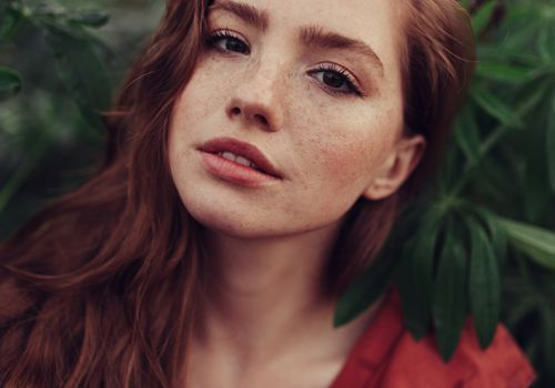 Red headed woman with clear skin in natural light