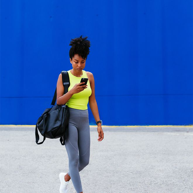 person walking in athletic clothing