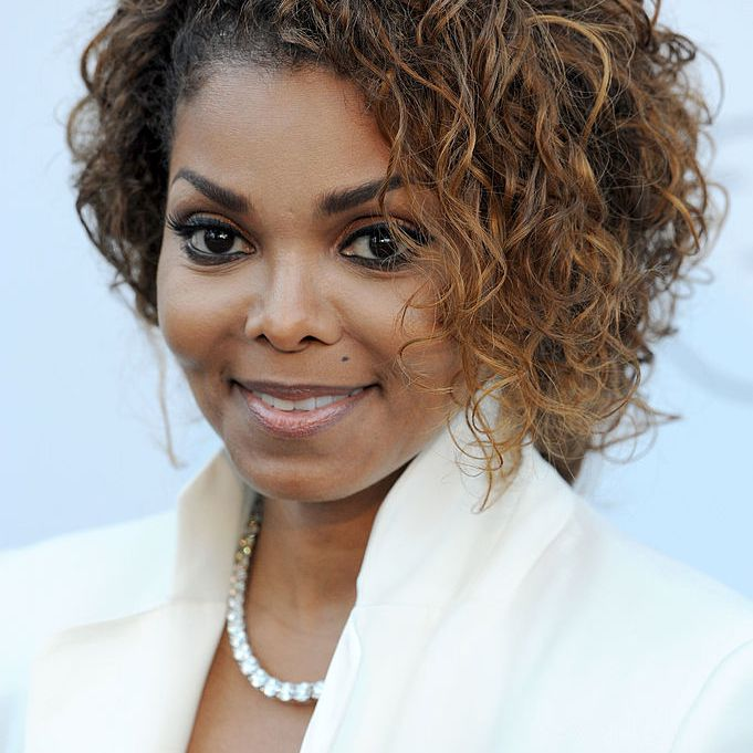 Janet Jackson curly bob with caramel highlights