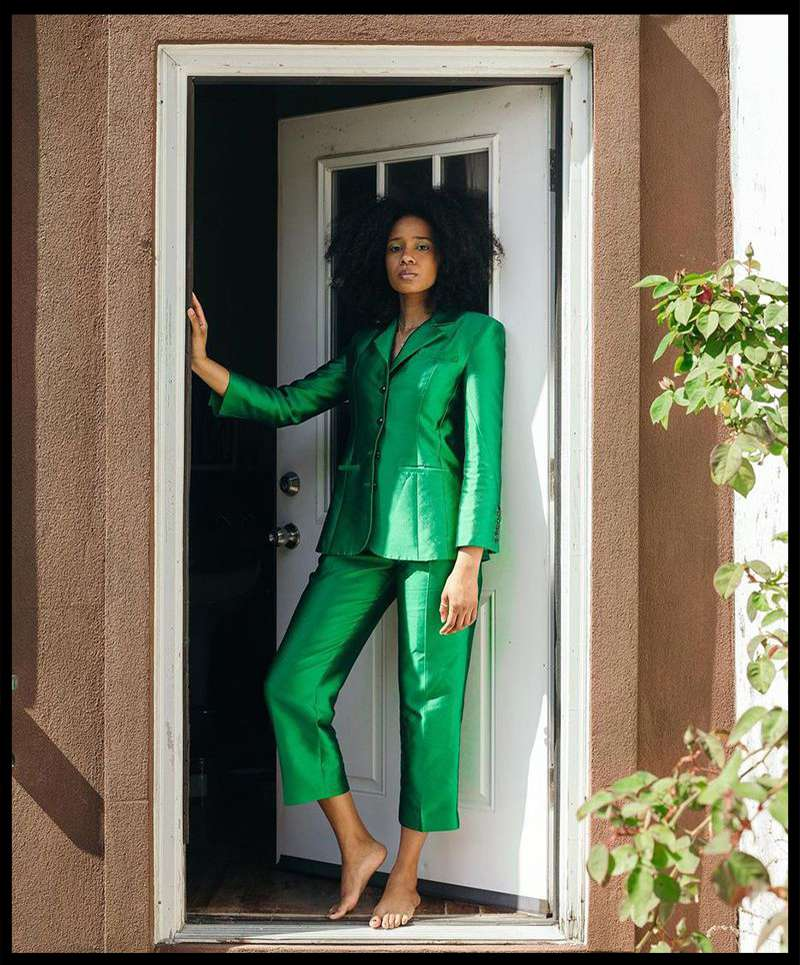 Naomi Elizée in a green suit