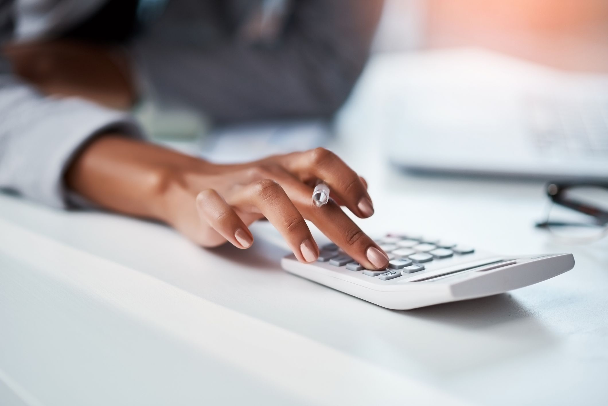 Woman's hand using a calculator
