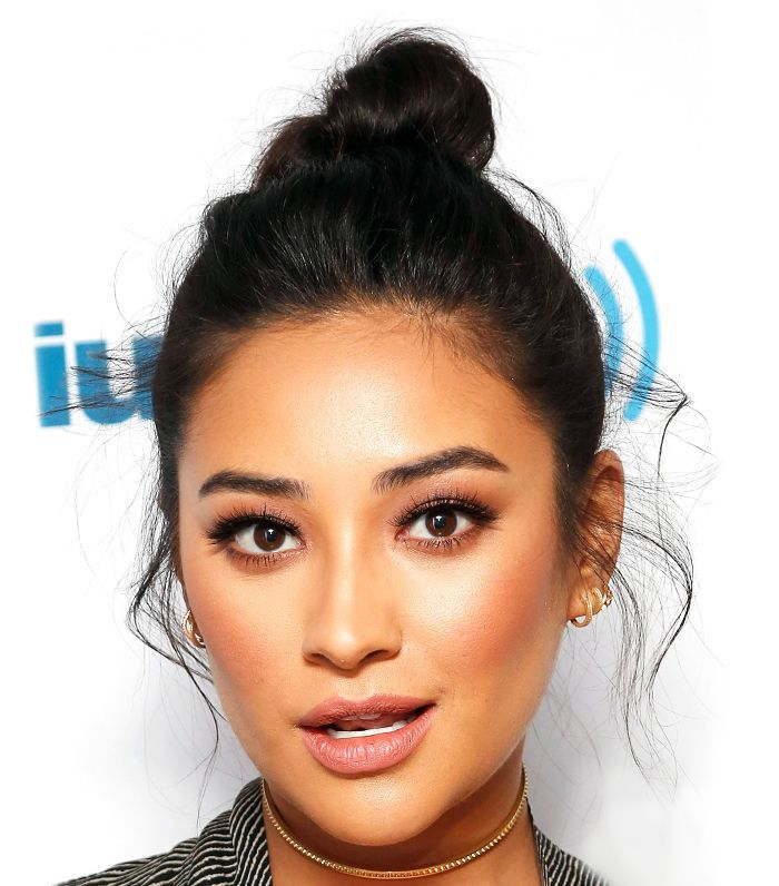 Shay Mitchel wearing a topknot