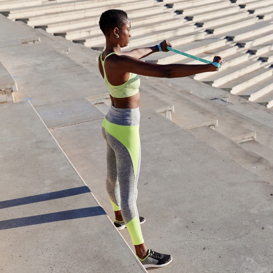 Woman doing arm band exercise