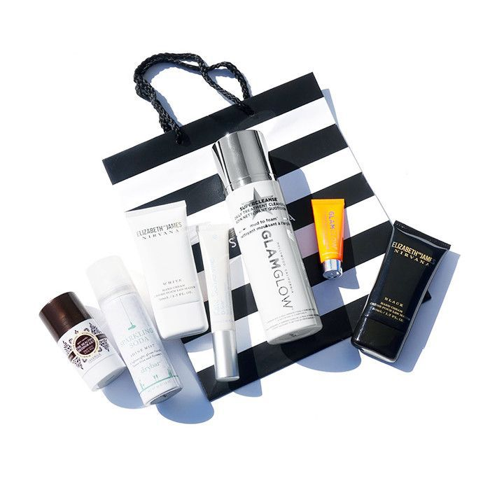 Assortment of beauty products atop Sephora shopping bag