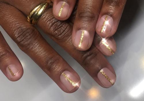 gold striped glitter manicure