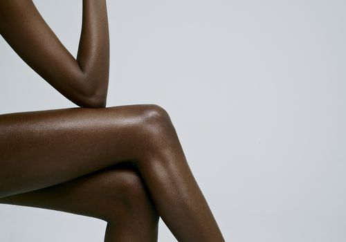 woman's legs posing against blue background