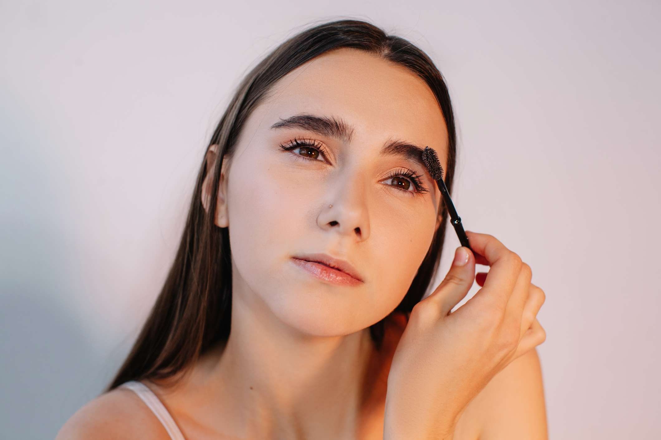 young woman doing her brows