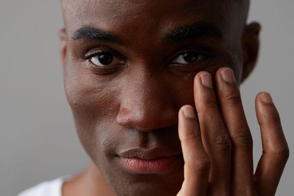 man wearing eye cream