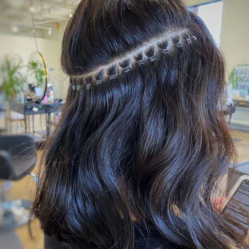 Hand-Tied Hair Extensions In Progress