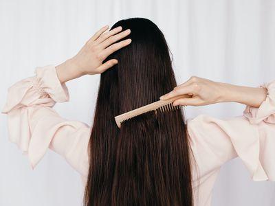 woman brushing straight hair