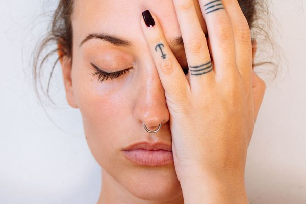 woman with tattoos covering her face