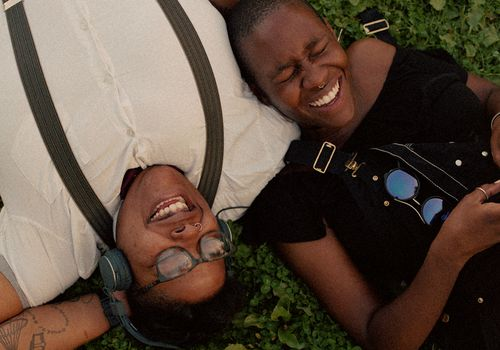 friends laughing on the grass