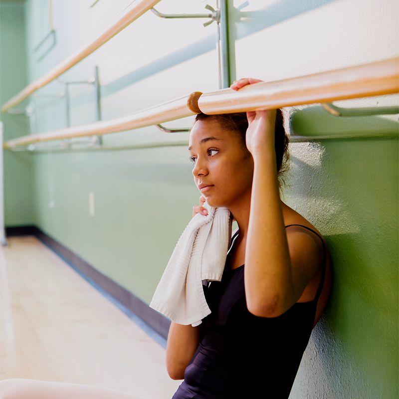 black femme resting at the barre