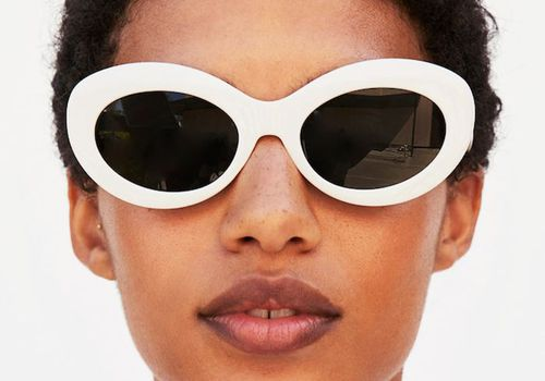 model with white sunglasses