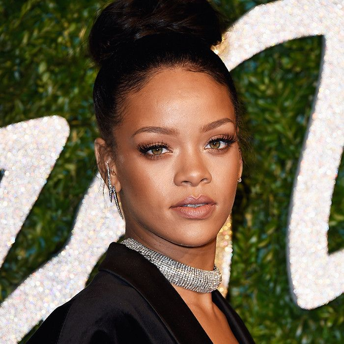 Rihanna wearing a top knot and a studded choker necklace