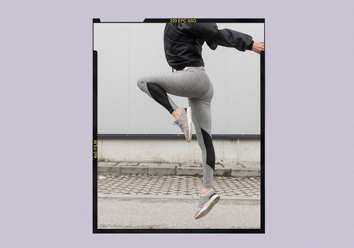 Woman jumping in fitness clothes.