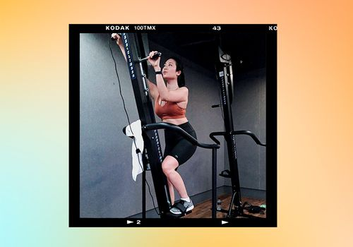person using versaclimber exercise machine