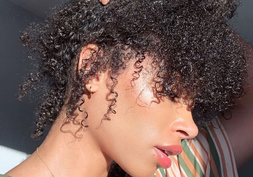 woman with natural hair looking to side
