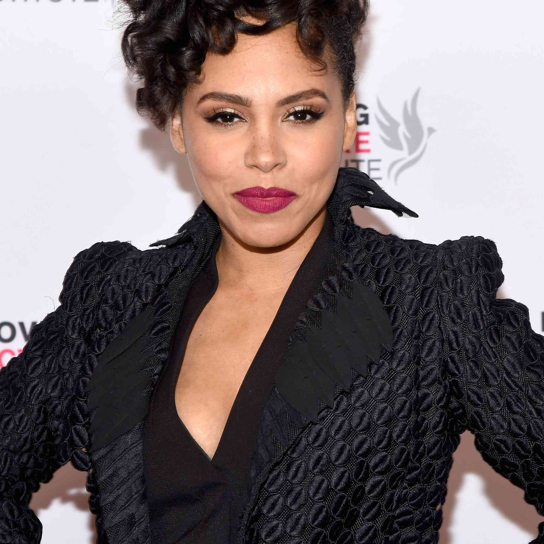 Amirah Vann posing on the red carpet of the premiere of