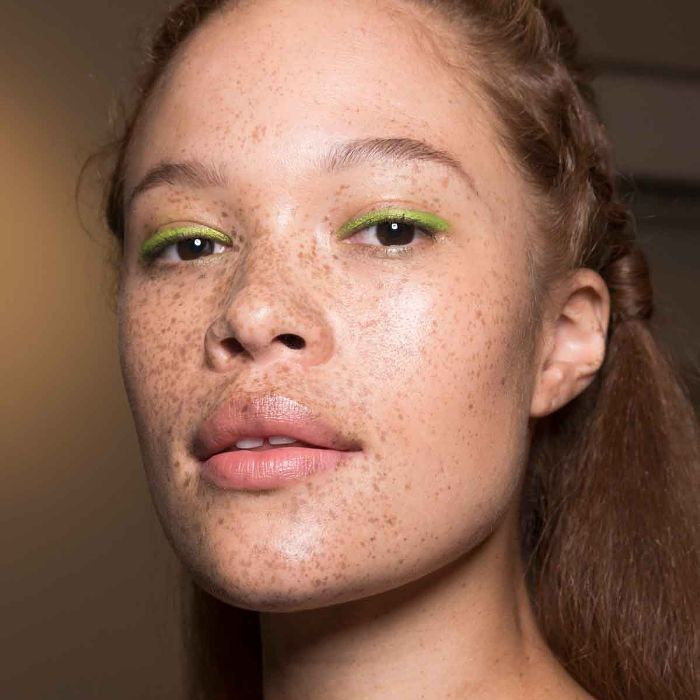 Model wearing neon green eyeliner