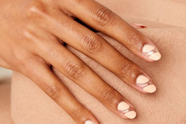 Person with negative space natural nails