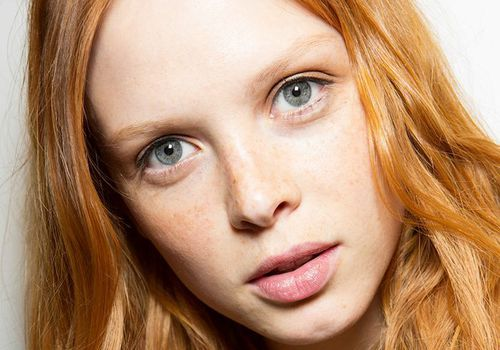 woman with red hair and green eyes