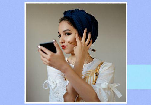 Young women doing her makeup