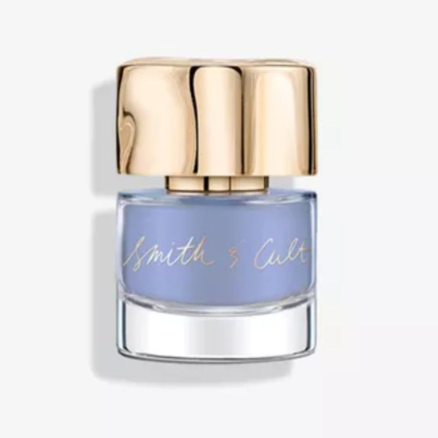 Bottle or iridescent periwinkle blue nail polish with a gold top.
