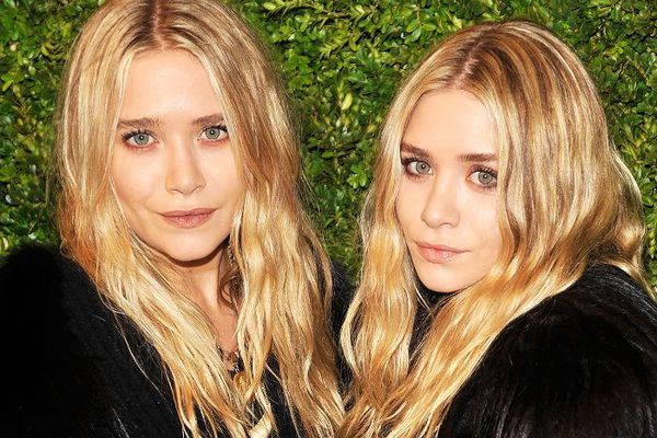 Mary-Kate and Ashley Olsen with long, wavy blond hair
