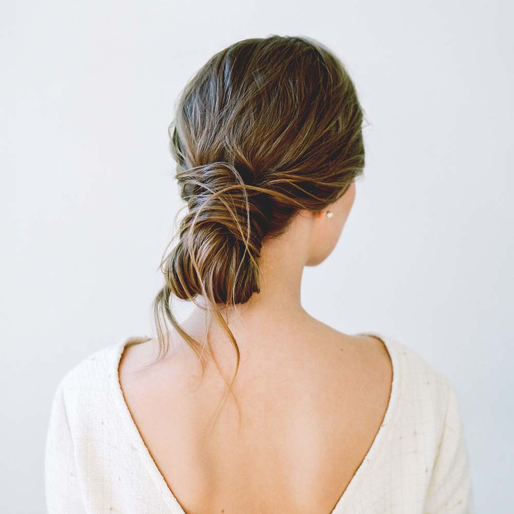 person with hair tied up in a bun