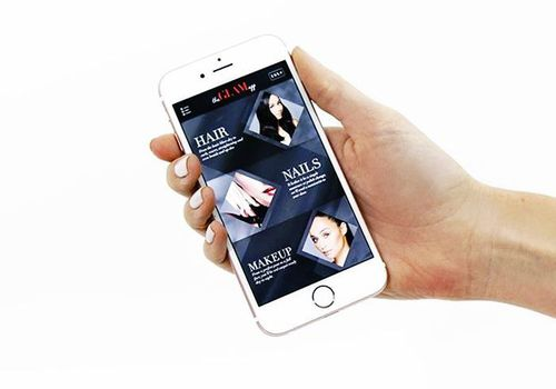 woman holding phone with glamsquad app