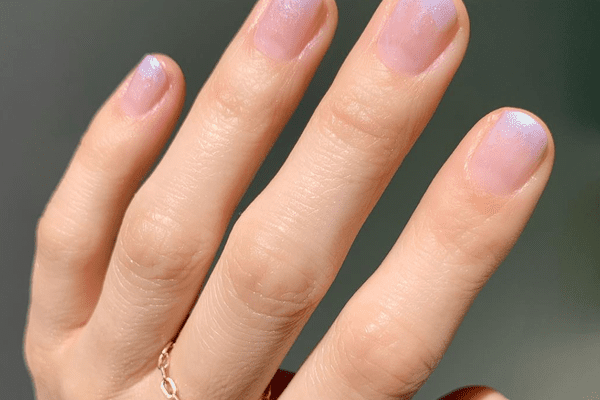 close up of pink ombre sparkle nails