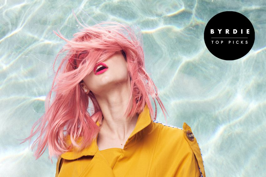 Photo composite of woman with shoulder length pastel pink hair blown into her face
