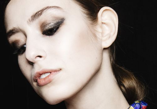 Closeup of female model with smoky, shimmery eye makeup
