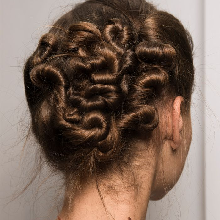 Model with hair in woven knots