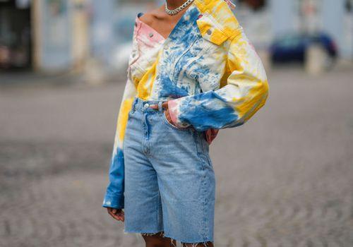 Woman wearing long denim shorts