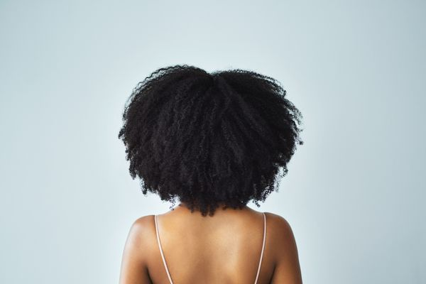 Black woman with kinky, curly natural hair and a smooth back