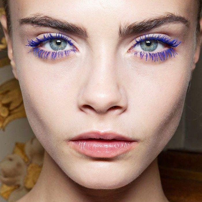 Cara Delevingne wearing blue mascara