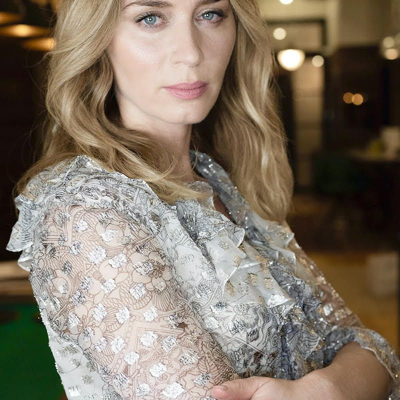 Emily Blunt sparkly blouse arms folded