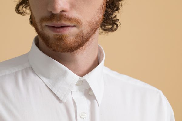 Up close of a masculine person with a red beard.