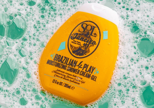 sol de janeiro shower cream gel floating in sudsy bathtub