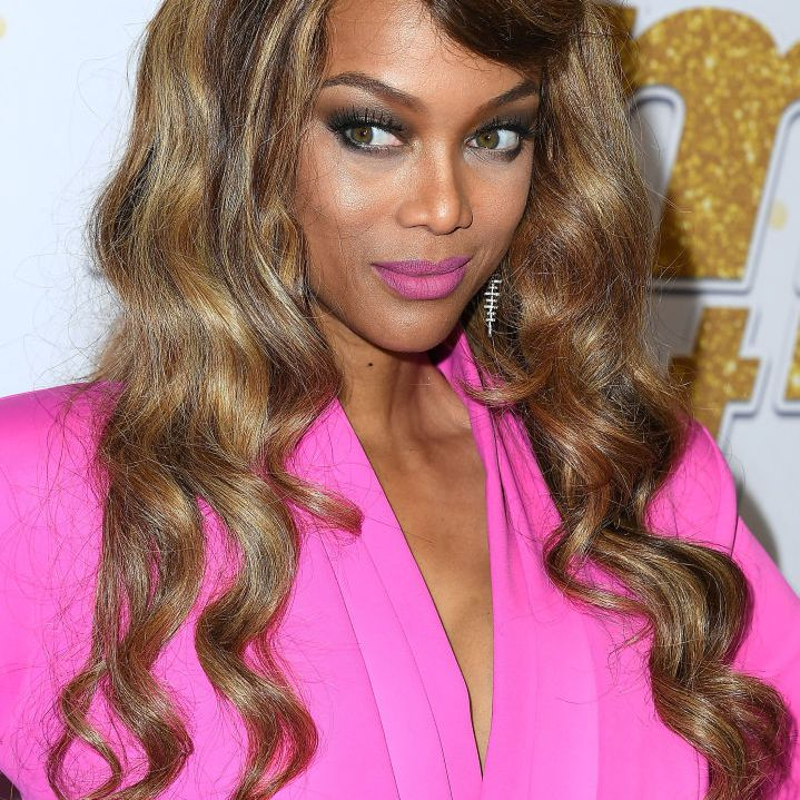 Tyra Banks long wavy hair with side fringe