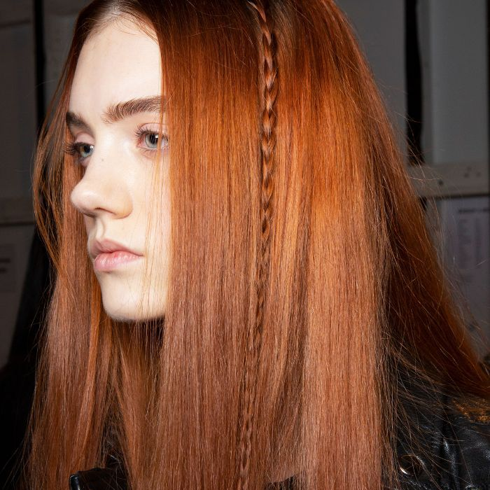 Model with single braid in red hair