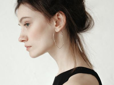woman with updo and earring