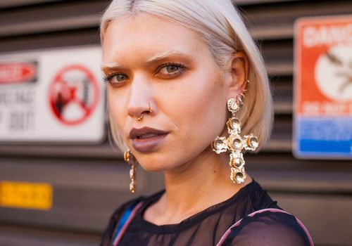 Woman with facial and ear piercings