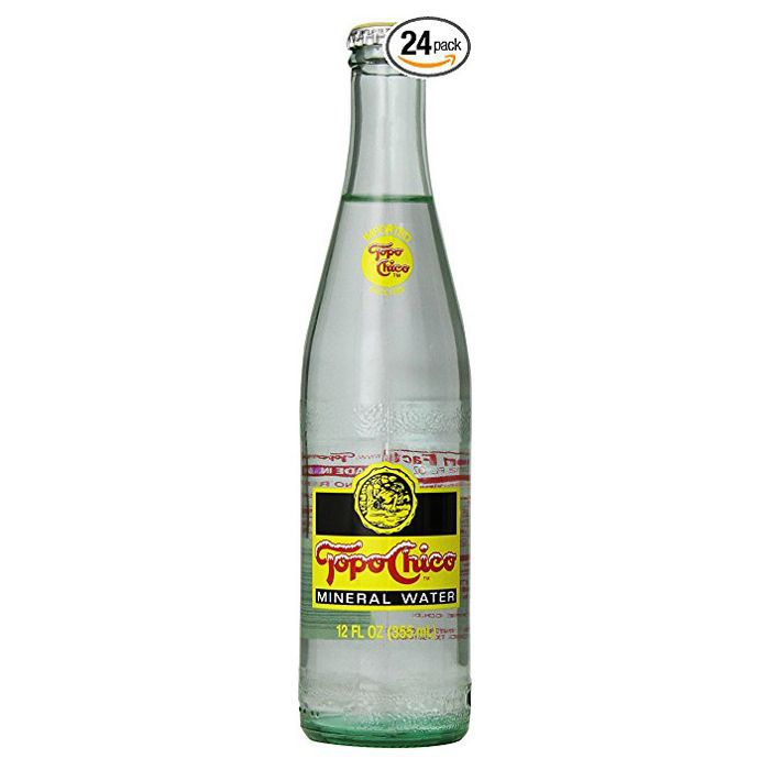 A glass bottle of Topo Chico mineral water.